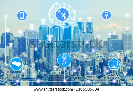 Smart city wireless communication network with graphic showing concept of internet of things ( IOT ) and information communication technology (ICT) against modern city buildings in the background. #1105585604