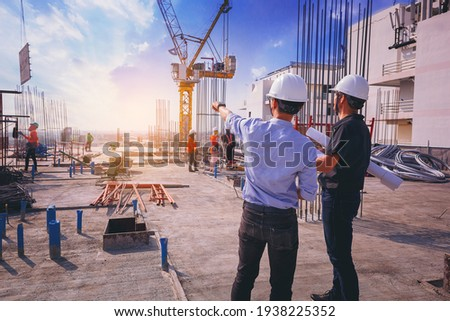 Smart civil architect engineer inspecting and working outdoors structure building site with blueprints. engineering and architecture concept.
