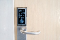 Smart Digital touch screen keypad access by entering pass code digits, Electronic digital door handles on wood door Hotel or apartment door, future modern safety security technology more safe secure