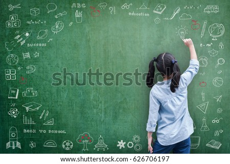 Smart educated Asian school girl kid student drawing doodle and writing on black classroom chalkboard background for national back to school month, educational inspiration and world literacy concept #626706197
