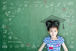 Smart educated school kid student with graduation hat doodle on chalkboard  for children's education success and scholarship concept