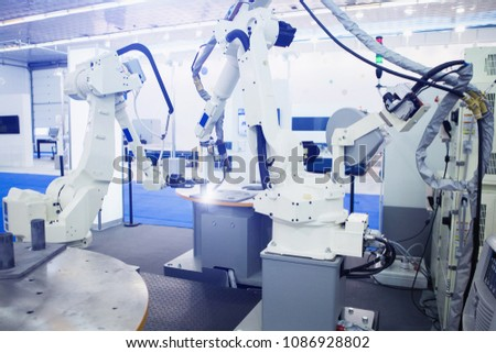 Smart factory. Assembly line with the robotic arms. Industry 4.0
