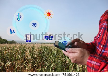 smart farmer,Agriculture concept ,Farmer using smart phone to monitor #751561423