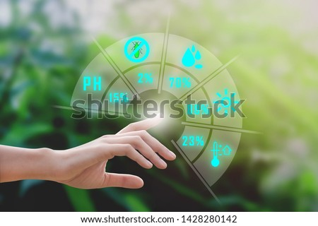 Smart farming with IoT, futuristic agriculture concept : farmer can monitoring monitoring rainfall, humidity, soil pH, insect on one finger click with immersive experience on digital hologram #1428280142
