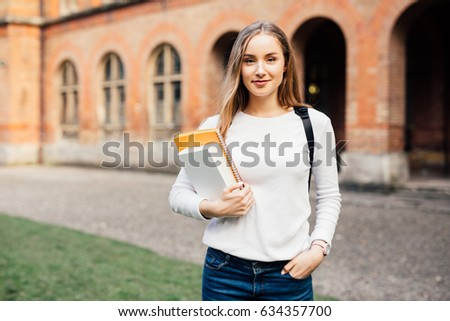 smart female college student on campus outdoors