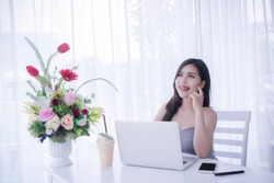 Smart girl's using laptop and happy time on work checking selling online , smile and laughing time work , workingwomen get think about work