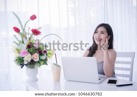 Smart girl's using laptop and happy time on work , smile and laughing time work , workingwomen get think about work