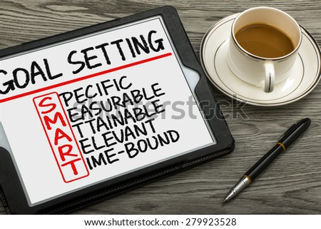 smart goal setting concept hand drawn on tablet pc