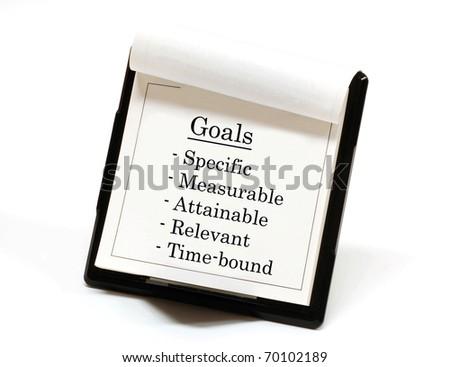 Smart goals listed on a desktop calendar