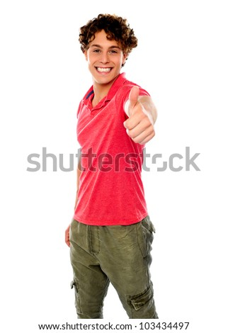 Smart guy standing with thumbs-up against white background