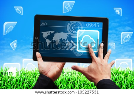 Smart hand press on Cloud icon on tablet computer