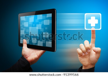 Smart hand press on First Aid icon from tablet pc