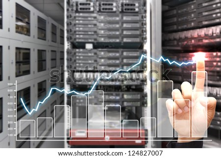 Smart hand press on graph report in data center room - stock photo