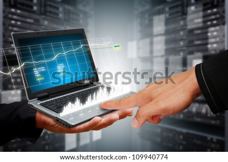 Smart hand touch on graph report in data center room #109940774