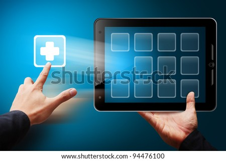 Smart hand touch the First Aid sign from tablet pc - stock photo
