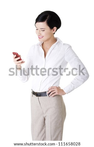 Smart happy young businesswoman using a smartphone