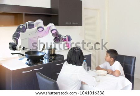 Smart Home Concept, mother and son are dining with intelligent robots, cooking and serving in the kitchen. #1041016336
