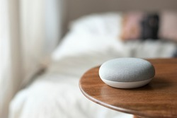 Smart home living with voice instructed speaker on the table