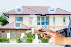 Smart home secured automation with wifi technology, Hand using smartphone as house mobile monitor such as camera, computer, door and light, internet of things, people and smart home concept