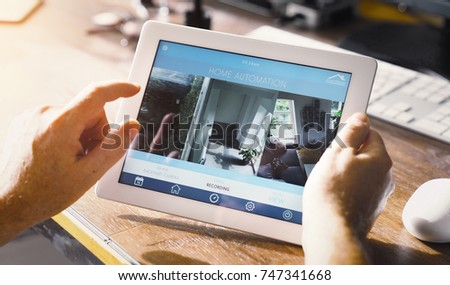 smart house device smartphone with app icons on tablet pc #747341668