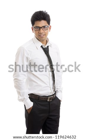 Smart Indian young businessman posing to the camera.