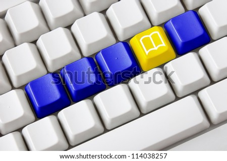Smart keyboard with color button and book symbol. Concept