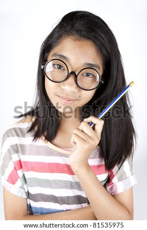 smart kid, Asian female kid with glasses hold pencil.