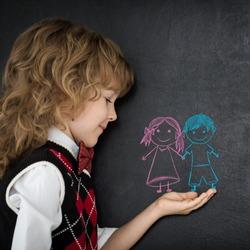 Smart kids in class. Happy children against blackboard. Education concept
