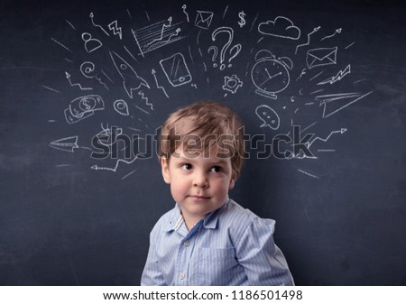 Smart little kid in front of a drawn up blackboard ruminate #1186501498