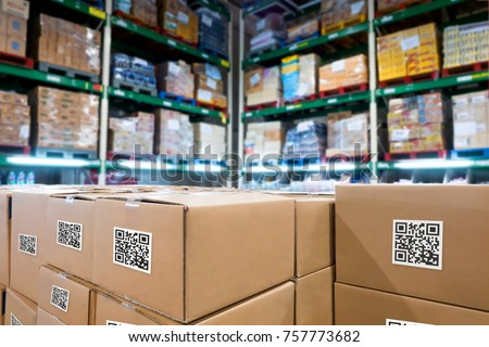Smart logistic industry 4.0 , QR Codes Asset warehouse and inventory management supply chain technology concept. Group of boxes in storehouse can check product inside and order pick time.