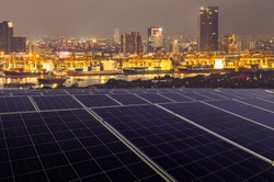 Smart Logistic port and renewable concept.solar panels linkage to  the city need power. Green energy for business.