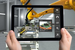 Smart Logistic warehouse technology , Augmented reality marketing , X-Ray packages box , industry 4.0 concept. Hand holding tablet to check items inside boxes.