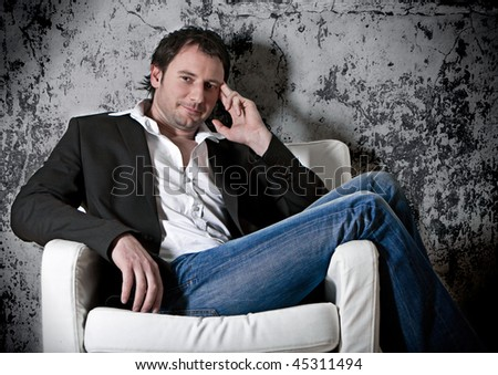 smart man sitting on an armchair