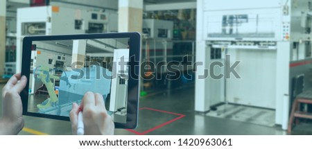 smart manufacturing ,industry 4.0, 5.0 technology concept, man use augmented mixed virtual reality technology to manage and simultion to install new machine in the factory predict, analytic how to fit #1420963061