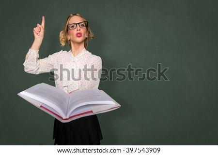 Smart nerd teacher substitute lecturing class with text book in classroom space for print