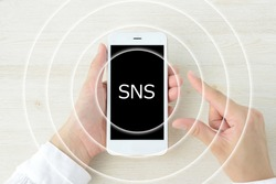 Smart phone and concentric circles with sns logo