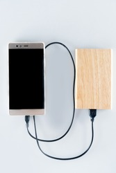 Smart phone and power bank are connected together by the charging cable