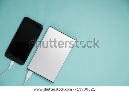 Smart phone connect to power bank on top view. #713930521