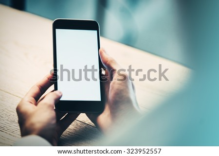 Smart phone holding in female hand.