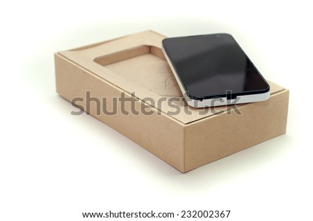 Smart Phone In Packaging Box On White Background