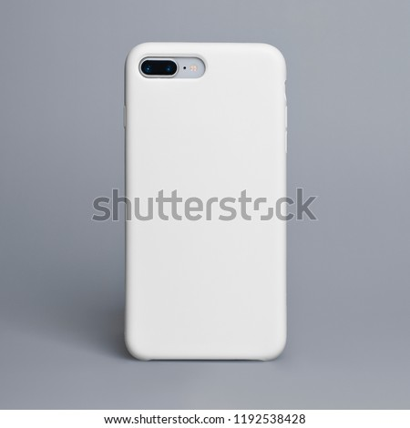 Smart phone on a gray background in a white plastic case back view. Template of iphone case