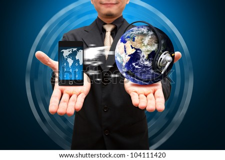 Smart phone on the hand and transfer Data to Digital earth : Elements of this image furnished by NASA