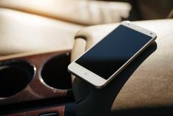 smart phone phone on the car seat dashboard