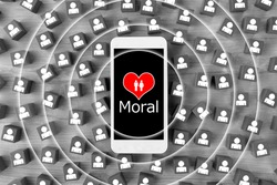 Smart phone with heart and moral word surrounded by wooden blocks with human pictogram