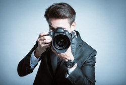 Smart photographer in suit.