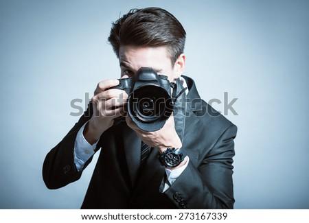Smart photographer in suit.