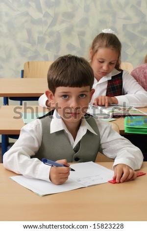 Smart schoolboy at lesson