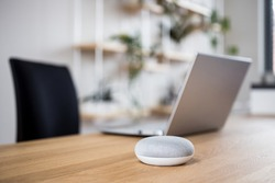 Smart speaker on table desk, voice controlled, device, smart home assistant, music streaming