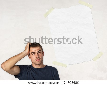 smart thinking man and white blank paper and light background