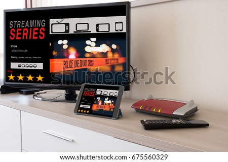 Smart tv and digital tablet connected to the internet modem network #675560329